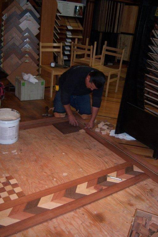 Fitting the border and first squares to the subfloor.