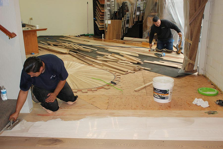 Gluing down the new flooring | Slaughterbeck Floors