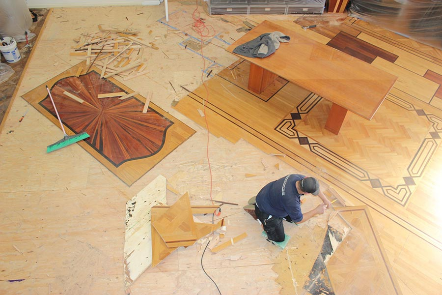 Pulling up the old hardwood flooring | Slaughterbeck Floors