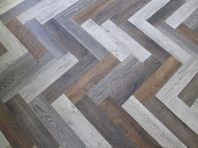 Luxury Vinyl Planks in Herringbone Pattern