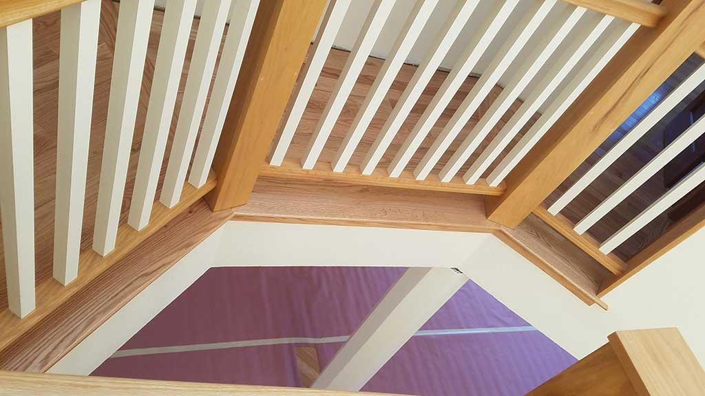 Hardwood Flooring Corner Bannister in a Los Gatos Home