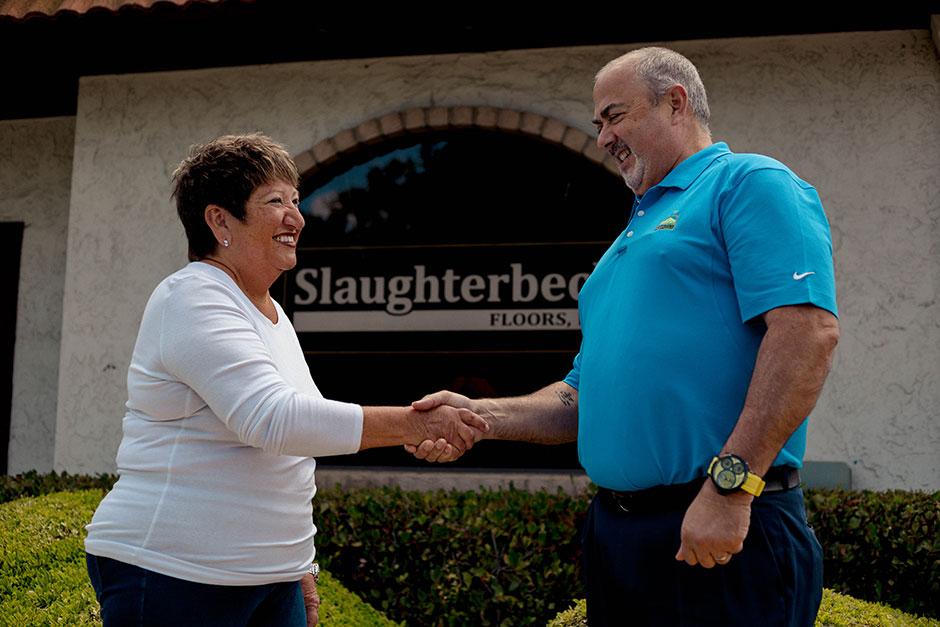 Joan Slaughterbeck and Paul Henthorn Handshake