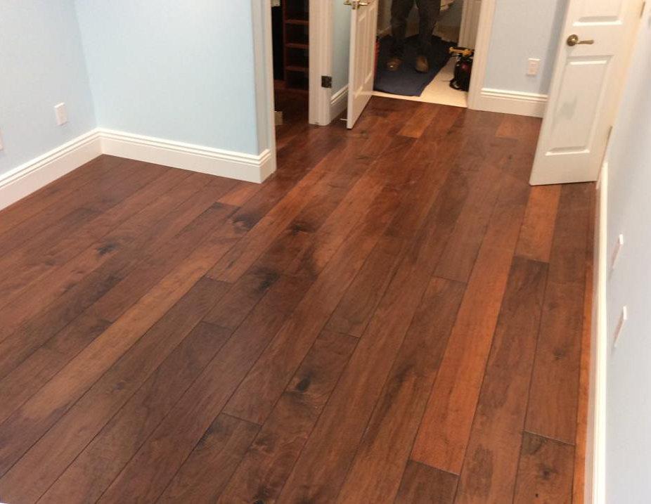 Walnut wood floors installed in bedroom