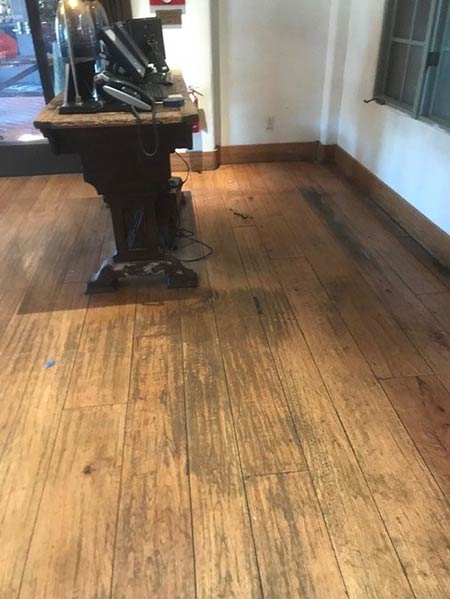 BEFORE - Old worn-down hardwood floors