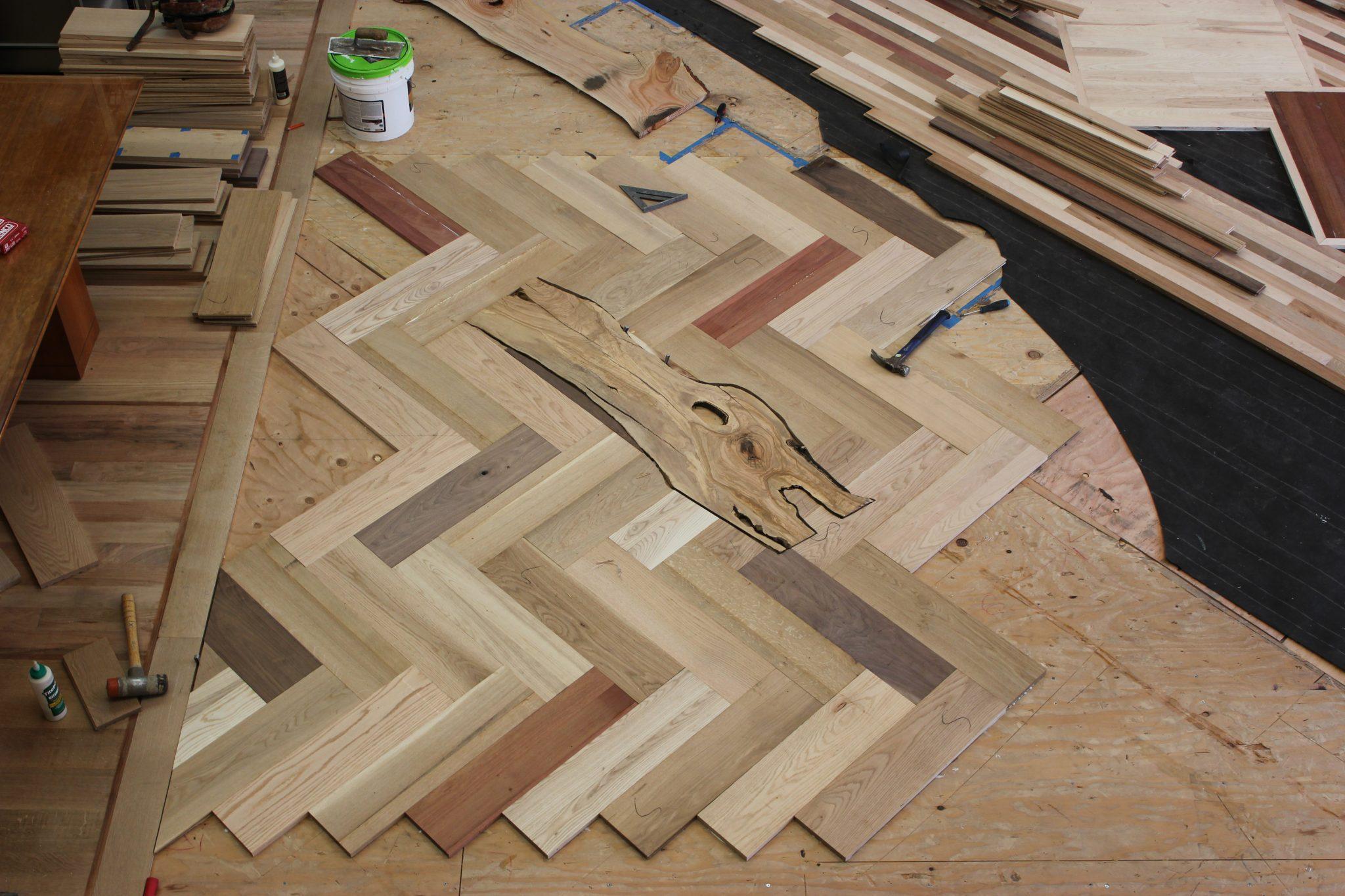 Herringbone pattern with a custom insert   Slaughterbeck Floors