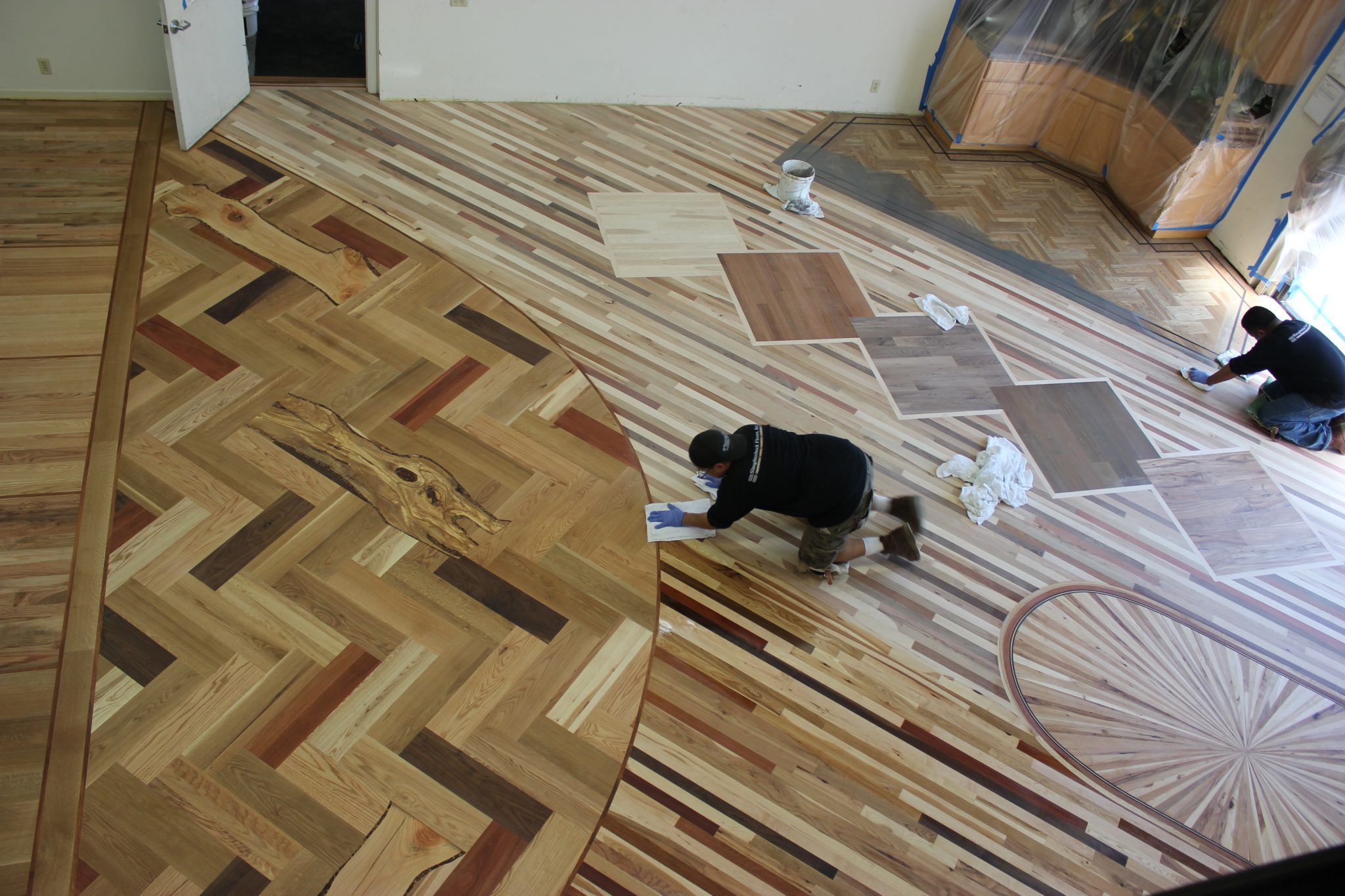 Applying finish to the floors   Slaughterbeck Floors