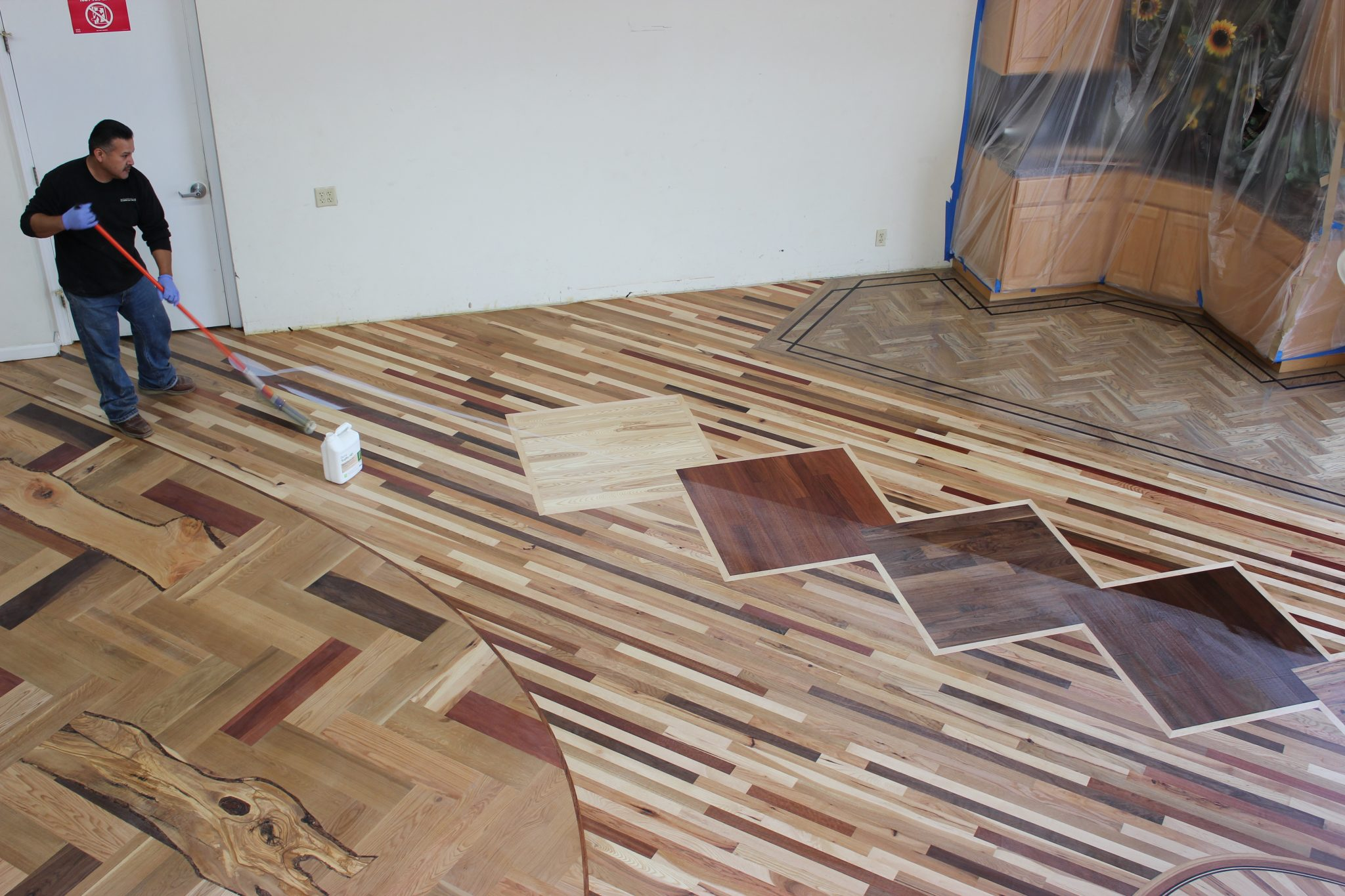Applying finish and sealing the floors   Slaughterbeck Floors