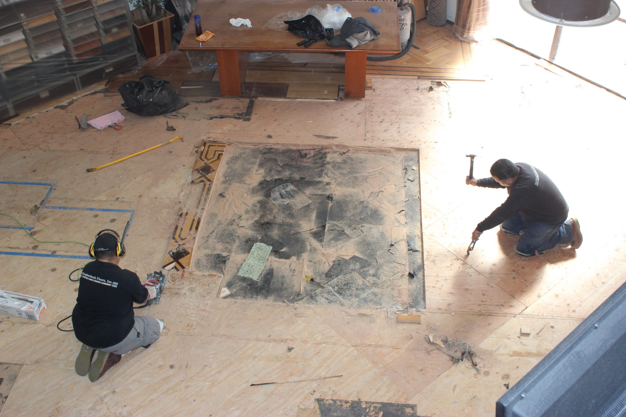 Removing the old nails from the floor   Slaughterbeck Floors