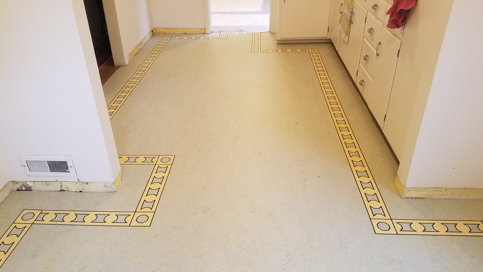 Custom border feature on linoleum floor side view