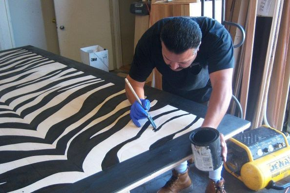 The stripes and border are painted with Ebony floor stain, then finished with polyurethane.