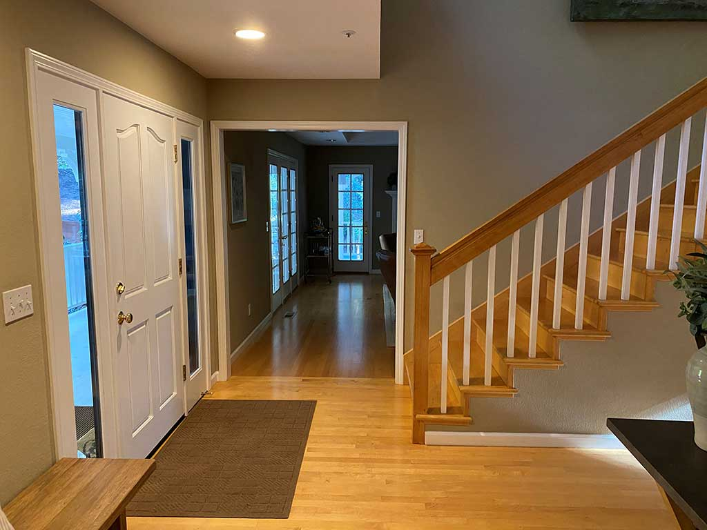 Staircase in Santa Cruz Home Before Hardwood Floor Restoration
